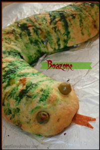 A calzone or pizza formed like a snake for Halloween fun food