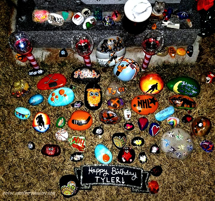 Rocks at the grave marker that are painted remarkably! Some with hockey sticks, hockey player or other hockey items; Tyler's favorite sport he played, some with his name, some Some have really awesome designs - all sorts of great paintings!