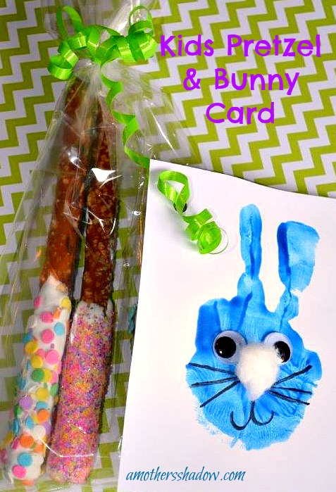 Really fun and cute card with the front decorated with a bunny face. The face is made from the child's hand-print. Then embellished with wiggly eyes, markers and cotton ball to make it come alive. A clear cellophane bag holds chocolate dipped pretzel rods that have been rolled in sprinkles.