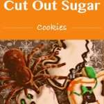 Cut out sugar cookies in halloween shapes with a glaze and decorated with gel frosing