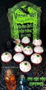 Red Cupcakes decorated with white frosting, topped with a candy eyeball and red gel icing