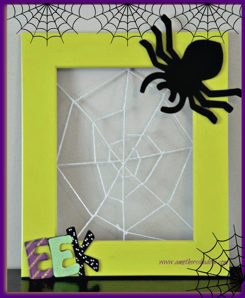 A wood frame with string inside to look like a spider web.