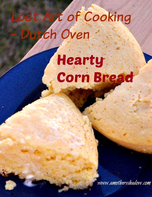 Duth Oven Corn Bread cooked on the coals outside