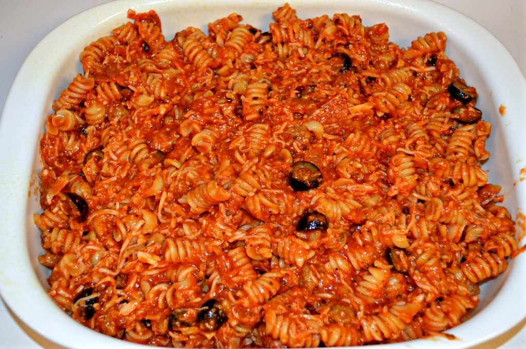 A hearty casserole full of pizza flavors from the hearty sauce, pepperoni, olives and cheese all mixed into pasta.