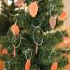Artificial tree with paper leaves that have names written on them of people to serve