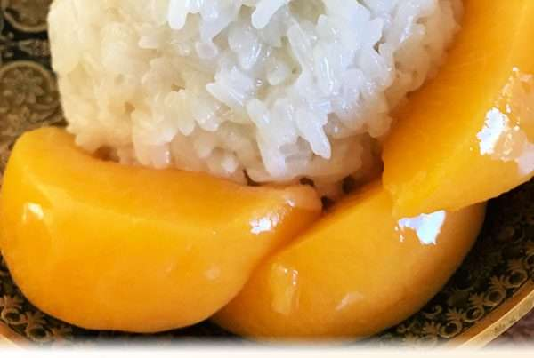 Thai sticky rice with sweetened coconut cream and mangos or peaches