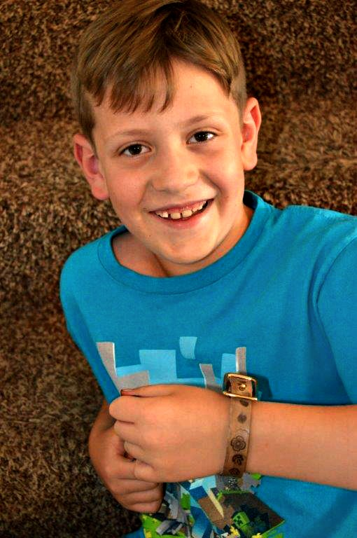 Boy with leather worked wrist band